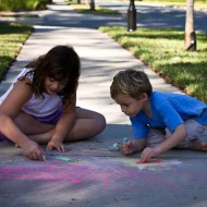 kids playing with sidewalk chalk